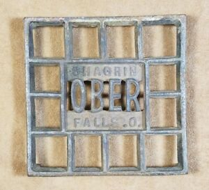 Vintage Ober Chagrin Falls Ohio Footed Cast Iron Advertising Trivet