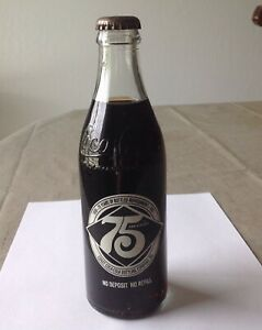 Coca-cola 75th Anniversary  bottle of coke full unopened 1899-1974