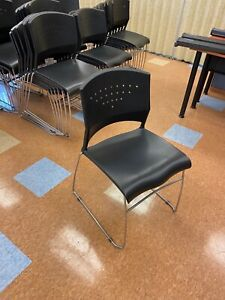 Plastic Stack guest side training Chair In Black Plastic Chrome Sled Base