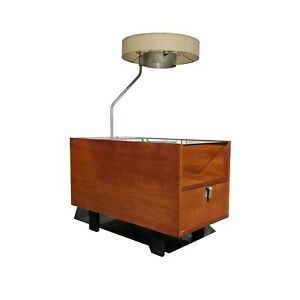 An Mcm Side Table With An Integrated Lamp By George Nelson For Herman Miller