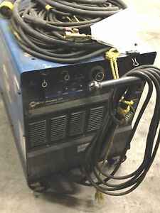 Miller Dimension 302 And Miller S 22a Wire Feed Both On Carts W Hoses Cables