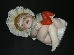 Piano Baby Conta Boehme Figurine Putting A Red Sock On Large 11