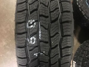 4 New 285 70 17 Cooper Discoverer At3 4s 65k 4 Ply Tires 70r17 R17 70r