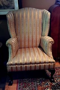 Beautiful Wing Back Chair Upholstered In Gold Silk With A Floral Pattern