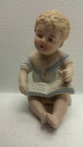 Porcelain Piano Baby Sitting Reading A Book Finger In Air 23 114 5 Tall