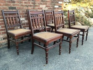 Six Antique Caned Dining Chairs