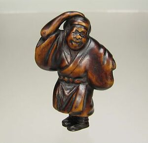 Late 18th Century Japanese Wood Netsuke Merchant