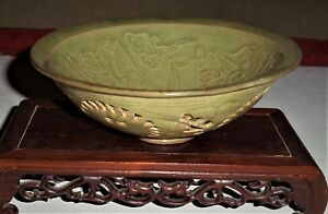 A Song Dynasty Yaozhouyao Celadon Bowl With Crane And Carved Medallion Motifs