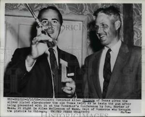 1955 Press Photo Shivers presented with silver plated six-shooter by Herter