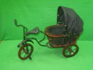 Vintage Antique Baby Doll Stroller Pulled By A Bicycle