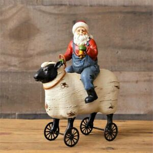 Primitive Country Santa Riding Sheep Figurine Pull Toy Wheels Turn