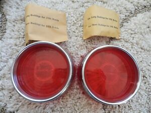 1956 Nos Pontiac Star Chief Tail Light Lens W Chrome Trim Ring Pair