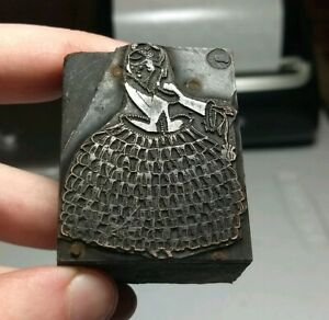 Vintage Letterpress Printing Block Woman Wearing Dress With Lots Of Ruffles