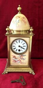 An Early French Brass Porcelain Panelled Clock
