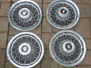 Set Of 4 Buick Wire Spoke Hubcaps Wheel Covers Part No 25505492
