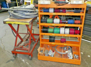 Electrical Wire Shop Rolling Rack With Many Rolls Of Wire Sealtite extras