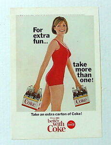 1965 COCA COLA AD SEXY LADY RED SWIMMING SUIT CARRYING CARTONS OF COKE