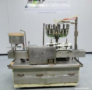 Used Pacific 16 head Positive Displacement Rotary Liquid Filler Includes Stain