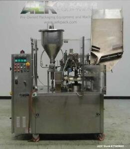 Used Comadis Model C130 Rotary Plastic Tube Filler Machine Is Capable Of Fill