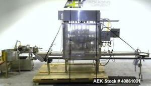 Used Filling Equipment Company 24 Head Rotary Vacuum Filler Capable Of Speeds