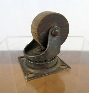 Vintage Bassick Small Metal And Wood Screw Mounted Swivel Roller Caster Wheel