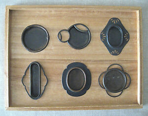 6 Different Antique Japanese Tansu Pulls Mounted For Display