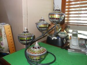 4 Mirrored Oil Lamps On A Wrought Iron Stand