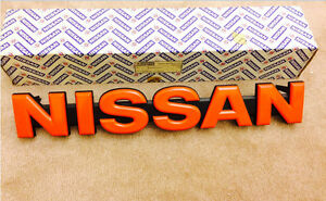Nissan Patrol 160 Series Grille Emblem Red New Never Used 62890 C8211 New Nos