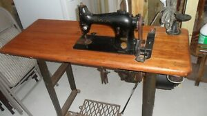 Vintage Industrial Sewing Machine On Heavy Wooden Table