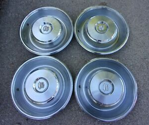 4 1965 Cadillac Fleetwood Deville Hubcaps Wheel Covers 15