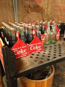 Antique Coca Cola bottles early 1900's filled with original cola six 6-packs