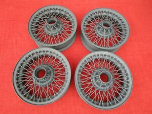Set Of Four Reconditioned Stock Oem 60 spoke 14 Wire Wheels For Mgb And Mgb gt