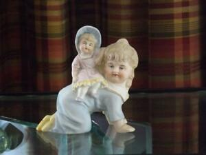 Piano Baby Huebach German Bisque Piggy Back Figurine Mint Condition