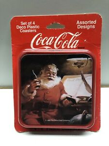 Coca Cola Coasters Set Of 4 Assorted Santa Claus Designs Deco Plastic Brand New