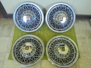 81 82 83 84 85 86 87 88 Oldsmobile Wire Spoke Hub Caps 15 Set Of 4 Wheel Covers