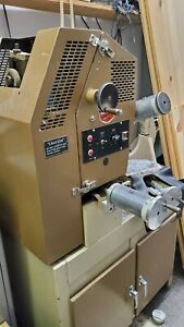 Coburn Optical 302 Lap Cutter Has Belt Drive Addition For Accurate Tooling