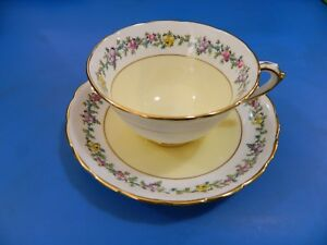 A Beautiful Flower Band Yellow Background Tuscan England Cup Saucer Set