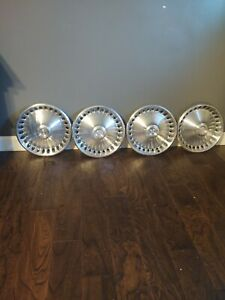 Vintage Plymouth Division Hubcaps 14