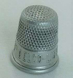Old Vintage Aluminum Thimble Delco Light Lightens The Burden Of The Housewife