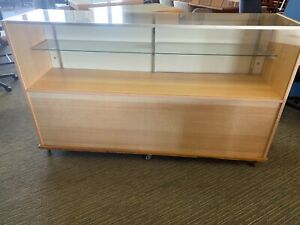Glass Display Case In Light Color Wood Comes On Wheels