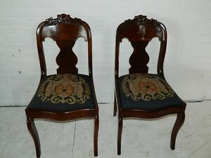 Antique Pair Walnut Empire Sabre Leg Chairs W Carved Crest Needlepoint Seat