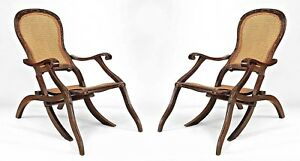 Pair Of English Anglo Indian Walnut Folding Campaign Arm Chairs With Cane Panel