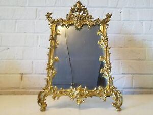 Antique Brass Beveled Standing Mirror With Ornate Floral Framing