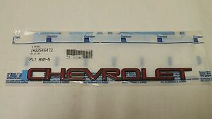 New Genuine Gm Nos Oem Chevrolet Emblem Red With Black Background