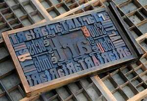 Collage art Made Of Letterpress Wood Type Characters In Antique Drawer Old