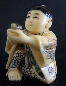 Japanese Ivory Colored Bone Netsuke Chinese Boy Offers U Swallow Bird
