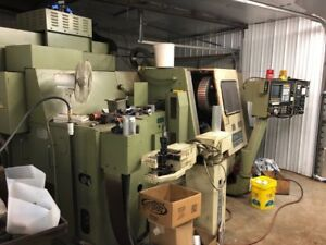 1990 Okuma Cnc Vertical Machining Center Lc20 4 axis Simulturn