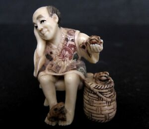 Japanese Ivory Colored Bone Okimono Netsuke Frog Man Sells Frogs Rattan Basket
