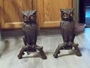Old Pair Cast Iron Owl Andirons Amber Colored Glass Eyes Reflective Eyes