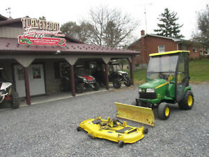 John Deere X700 With Cab With Snow Plow And Mower